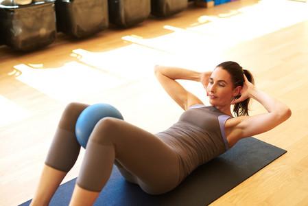Beautiful female is doing pilates