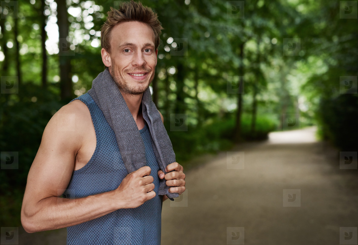 Jogging Man Smiles at the Camera While in a Break
