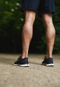 Legs of a fit muscular athletic man
