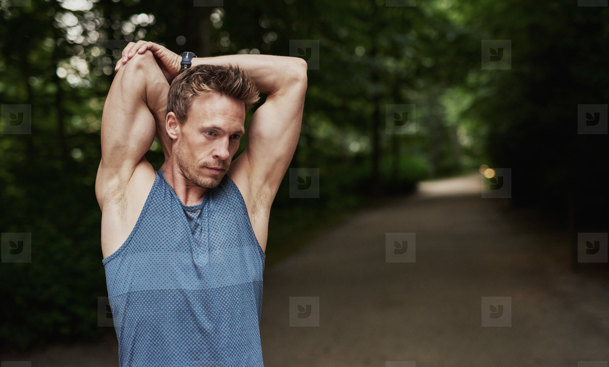 Athletic Man Stretching Arms Behind his Head