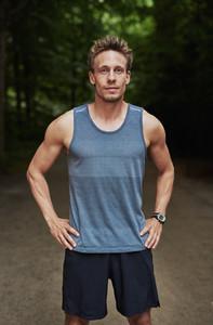 Athletic muscular man in sportswear