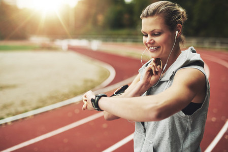 Young woman feeling the pulse before training