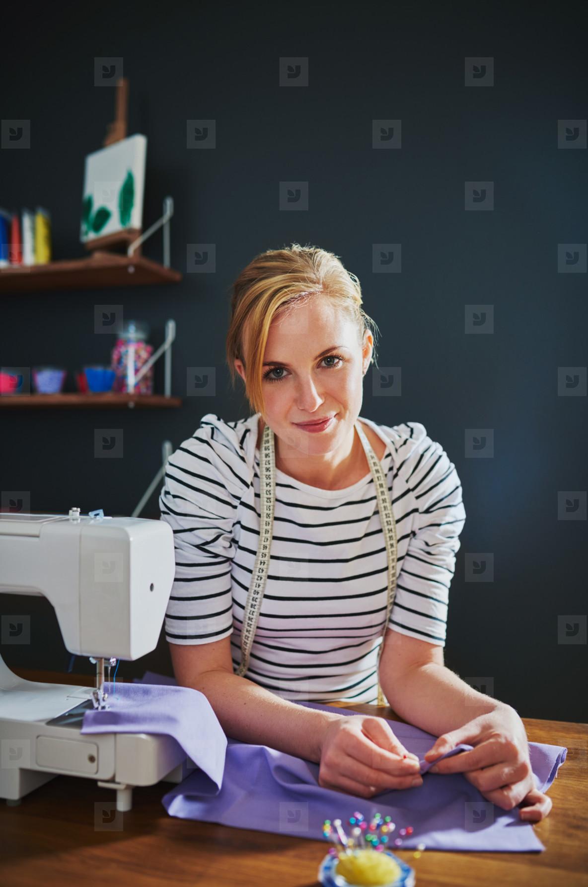 Creative woman smiling at camera
