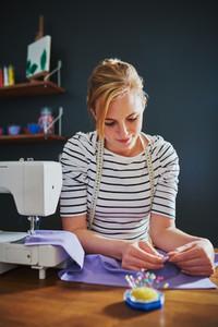 Female designer creating clothes