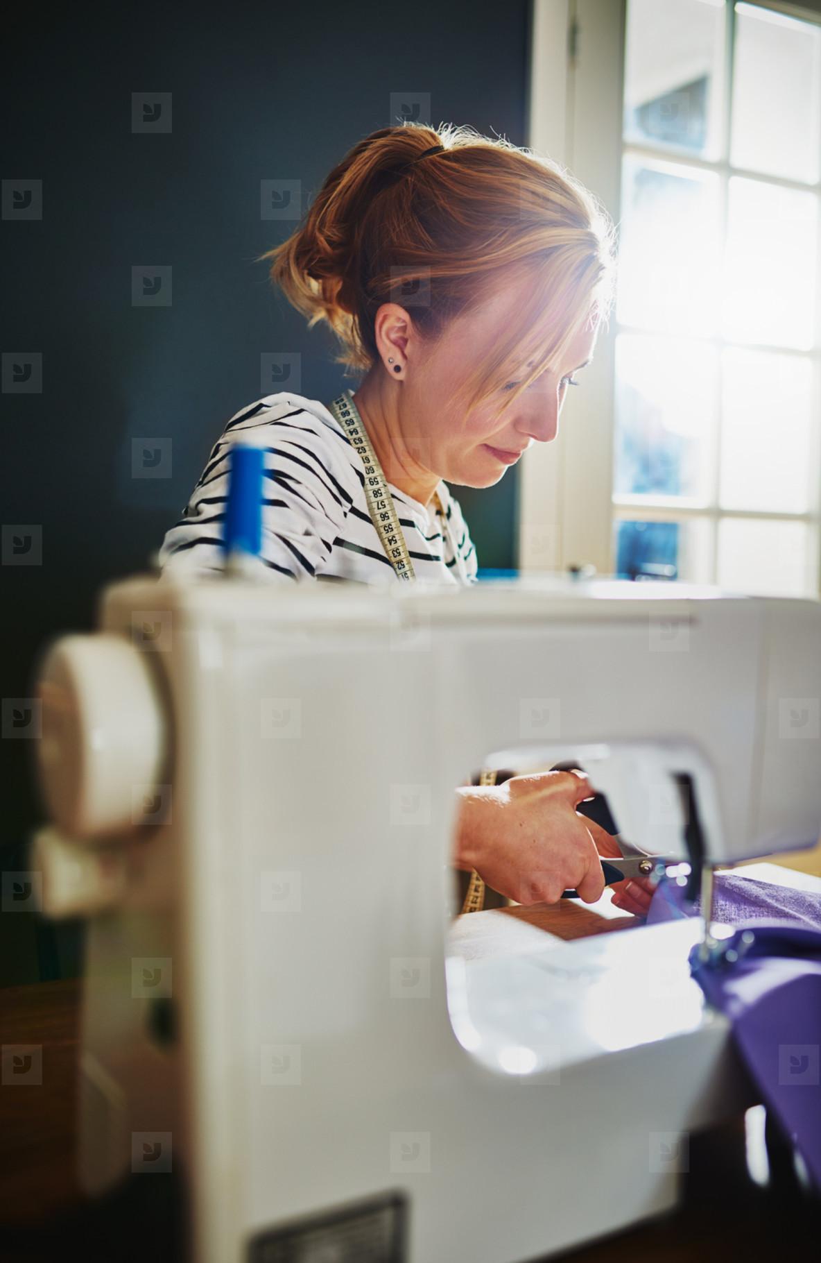 Fashion designer sewing