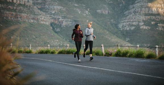 Female runner athletes running in the morning