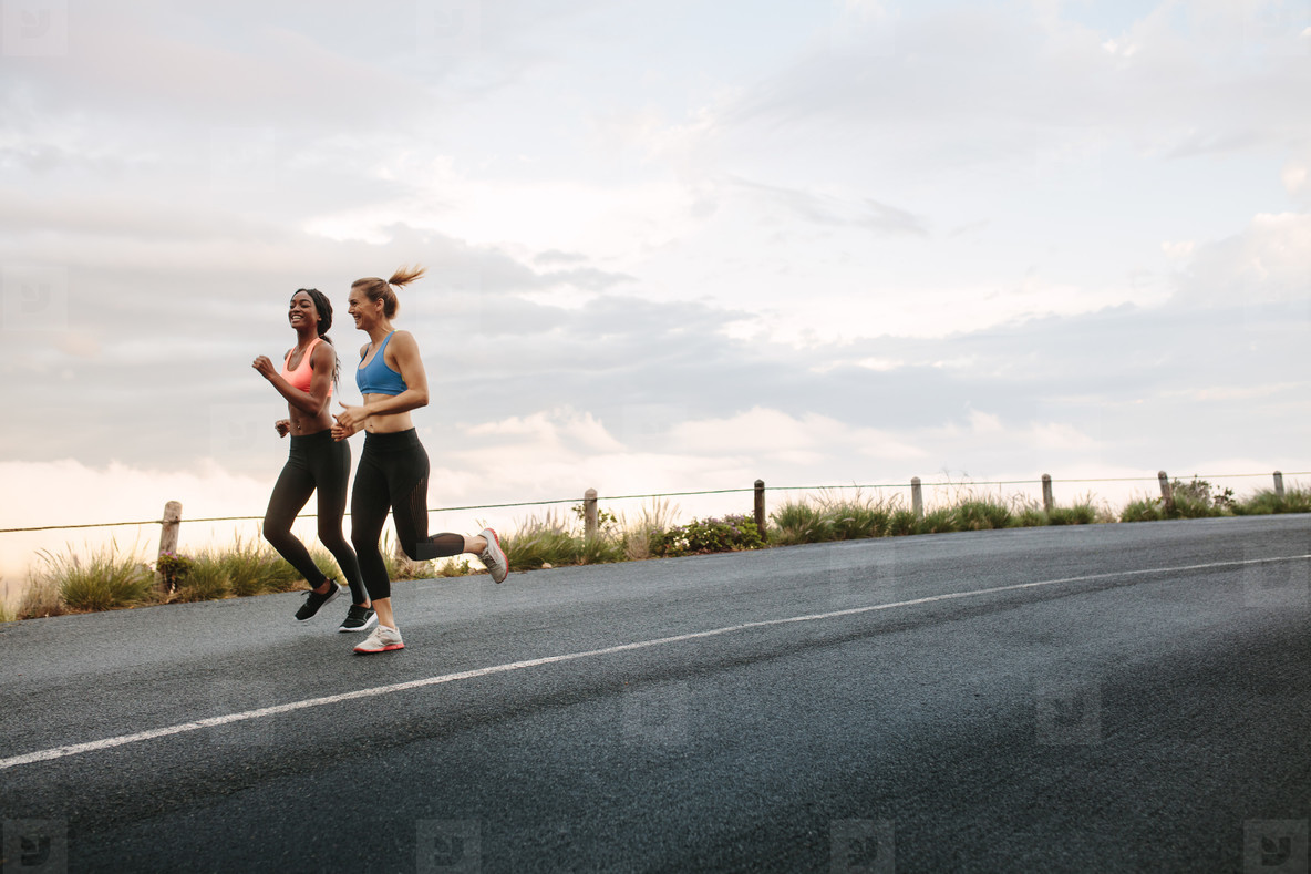 Two women athletes running