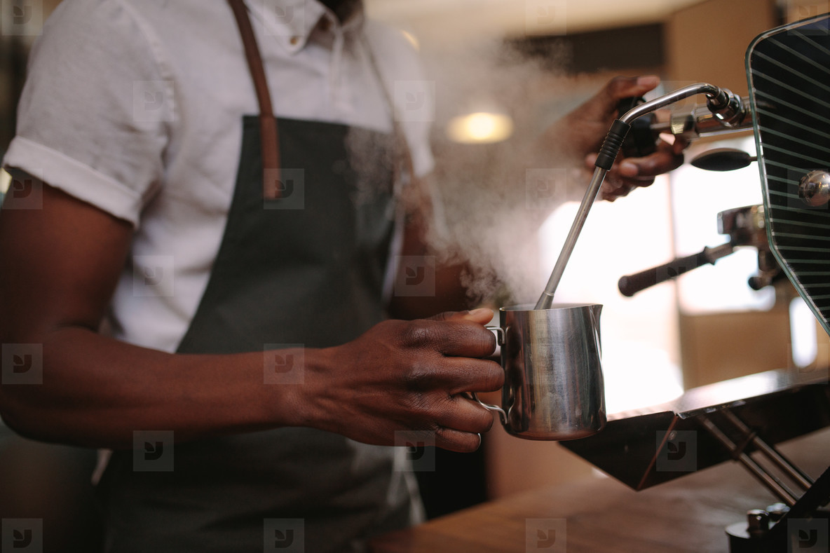 Barista preparing coffee at a coffee shop