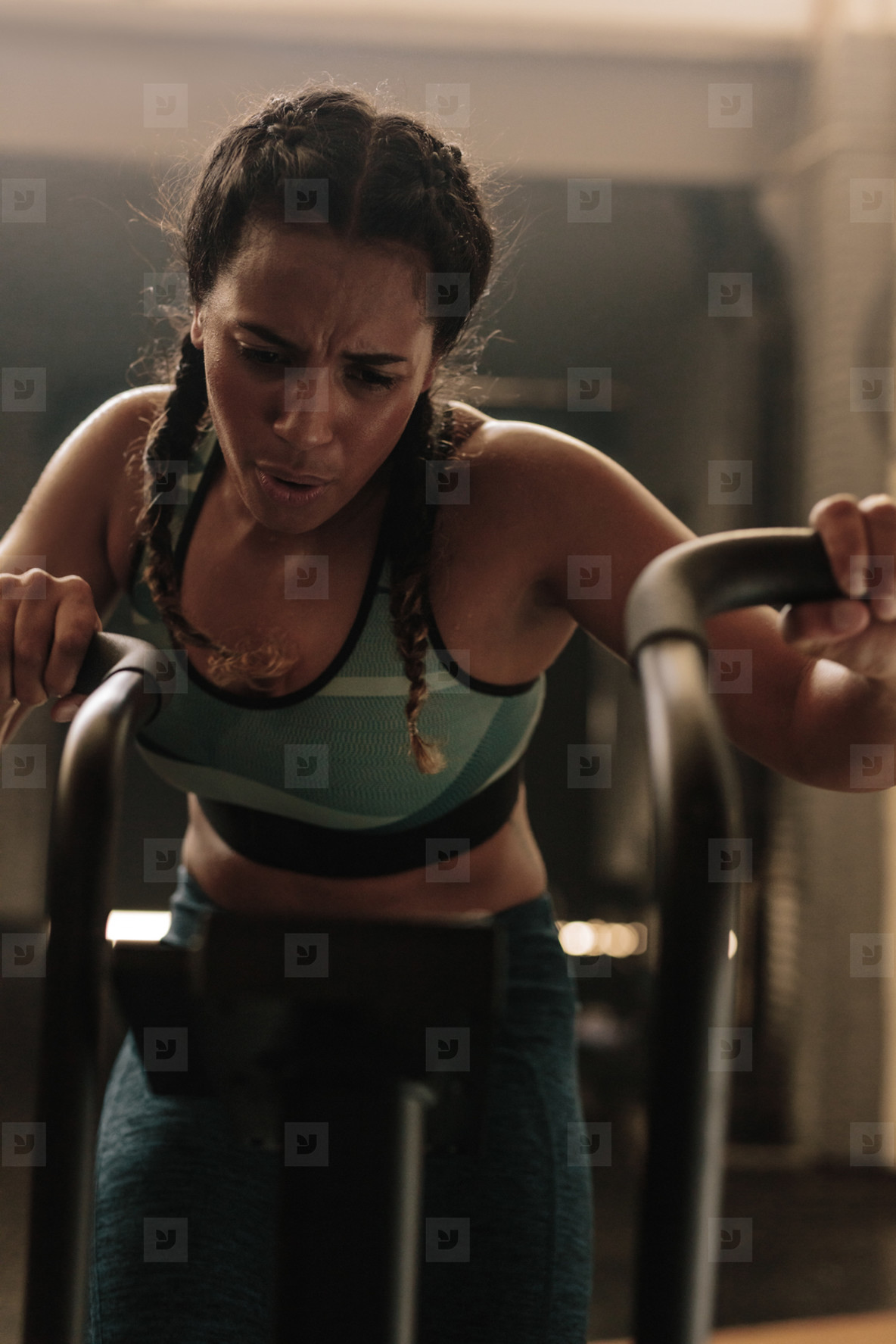 Female doing intense workout on exercise bike
