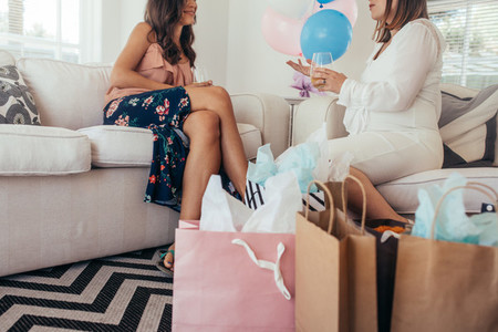 Pregnant woman talking with friend at baby shower