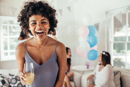 Laughing african woman at friends baby shower