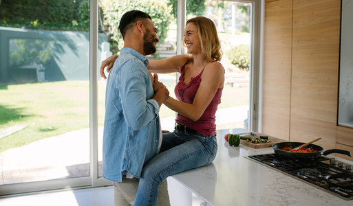 Romantic couple in their kitchen