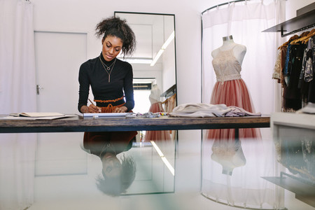 Woman entrepreneur at work in her boutique