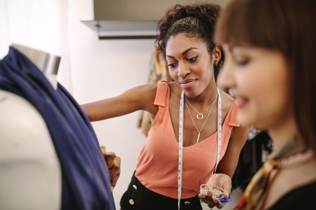 Woman fashion designers at work in their fashion boutique