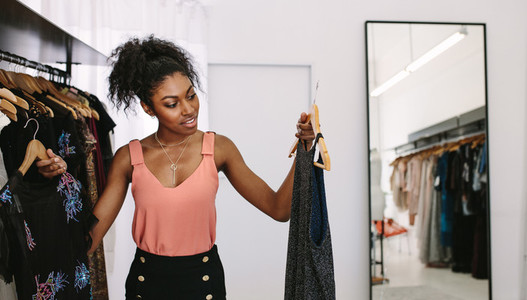 Woman entrepreneur in her fashion boutique