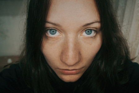blue eyes of girl looking at camera