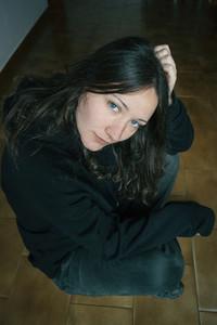 blue eyed girl sitting on the floor