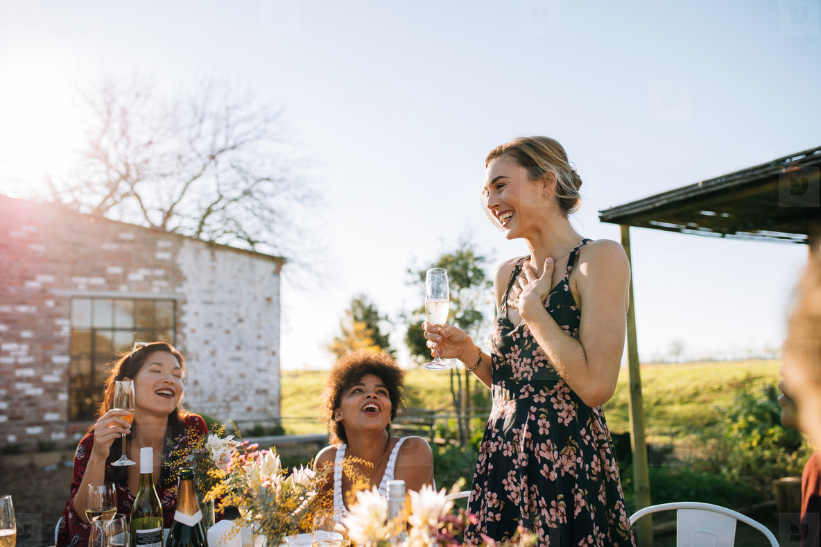 Woman sharing good news with friends  at party