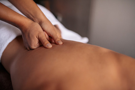 Woman getting massage spa treatment