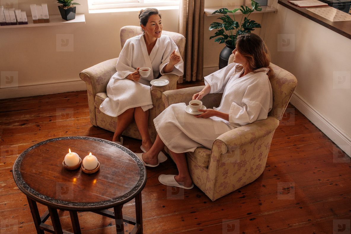 Two women talking while waiting for spa