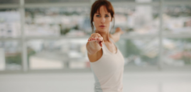Woman stretching her arms at gym