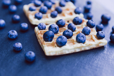 Closeup of waffles and blueberries for breakfast