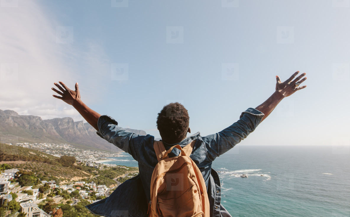 Man enjoying the view from top of mountain