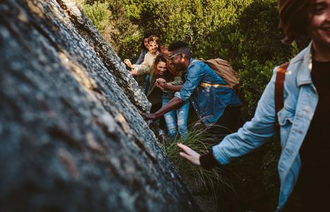 Friends walking through a mountain trail