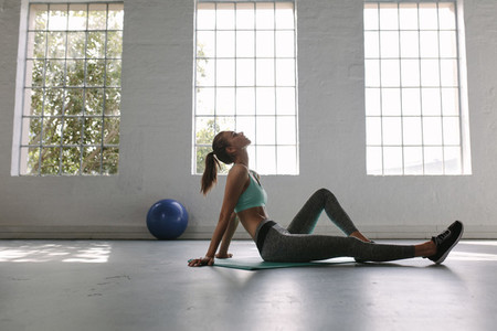 Woman relaxing at gym after workout