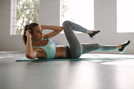 Woman in the gym doing sit up exercise