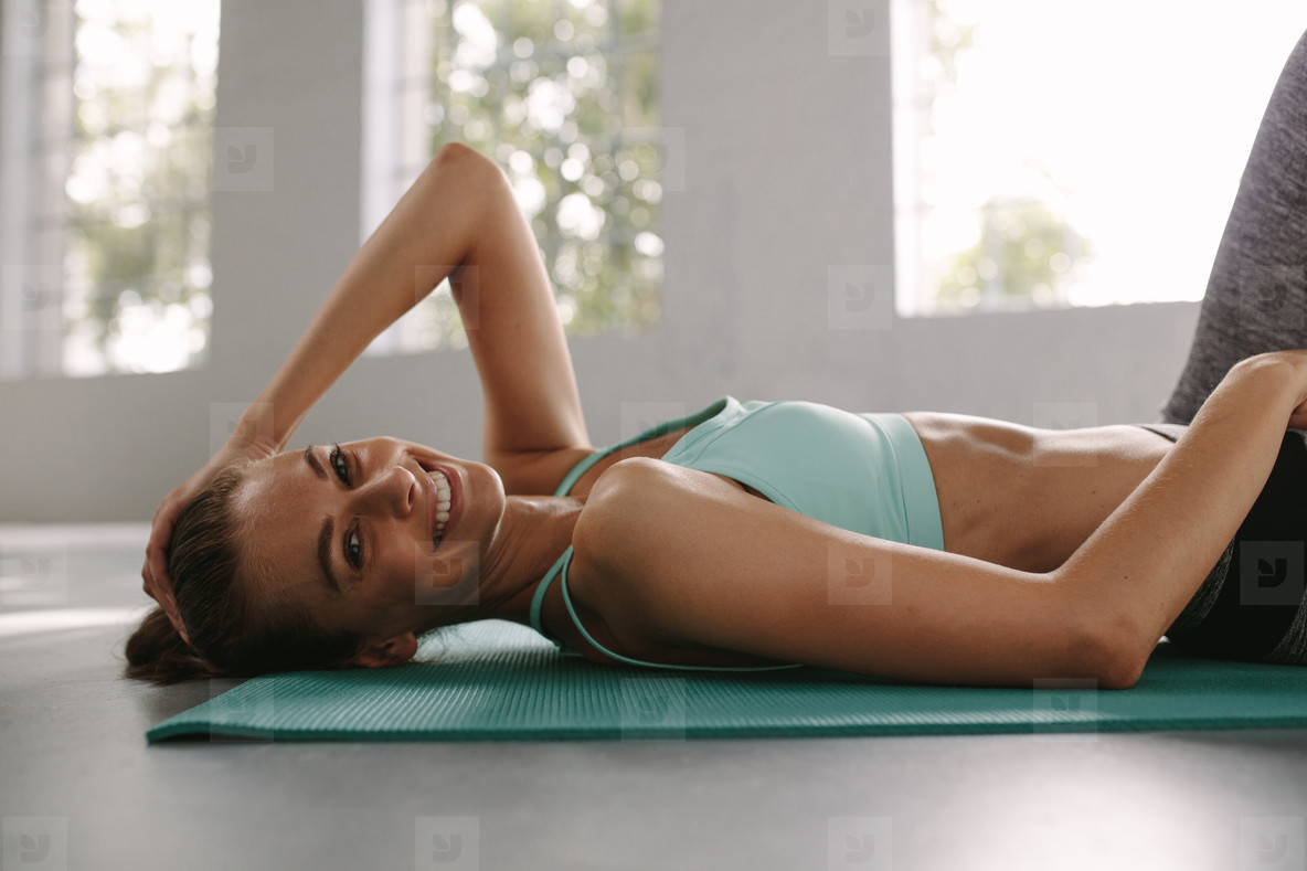 Female taking rest after fitness workout