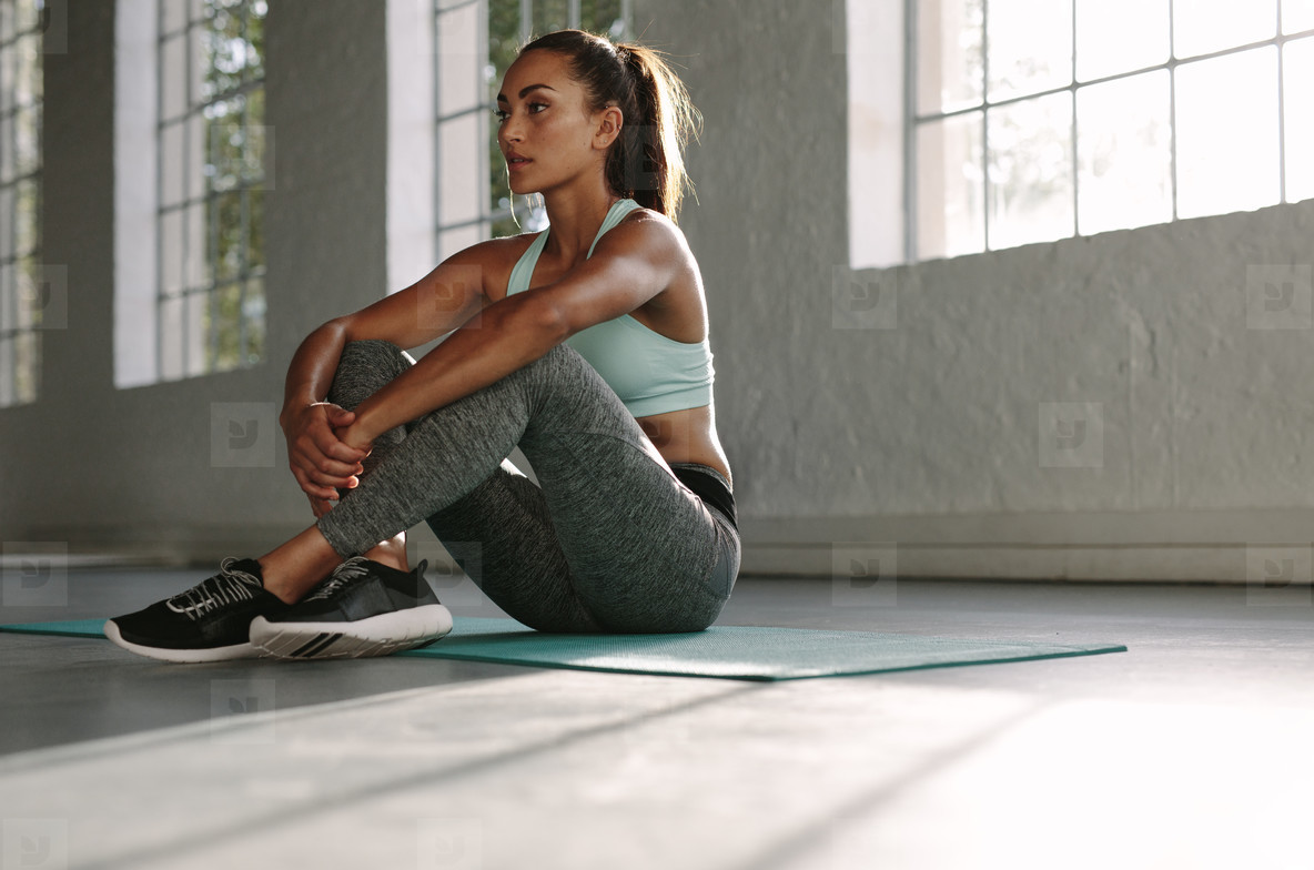 Woman resting after workout at gym