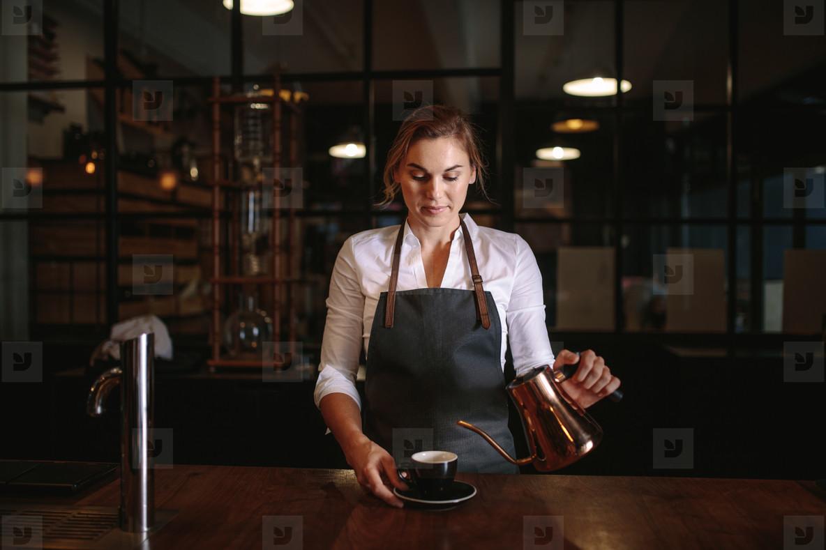 Female barista preparing coffee
