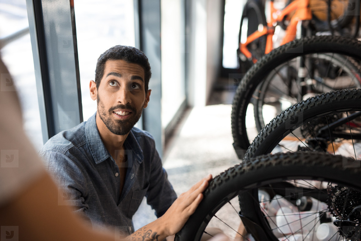 Man in a bicycle workshop