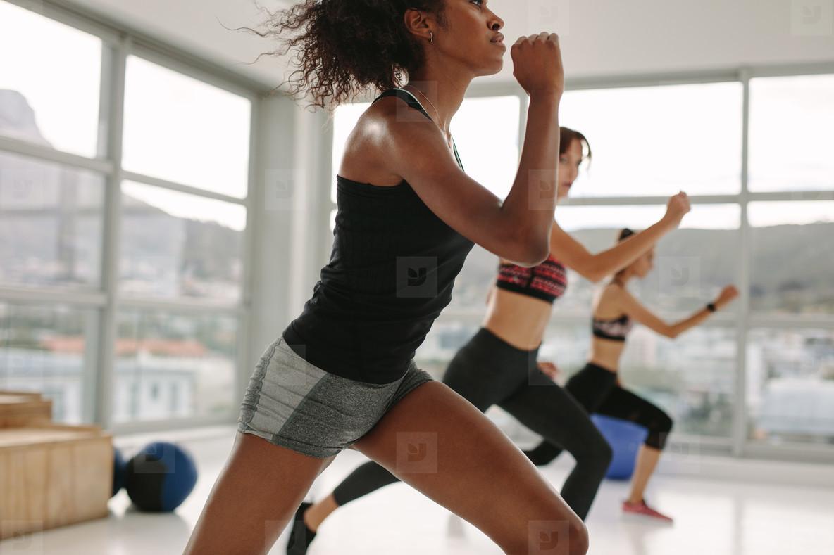 Young women having group aerobic training