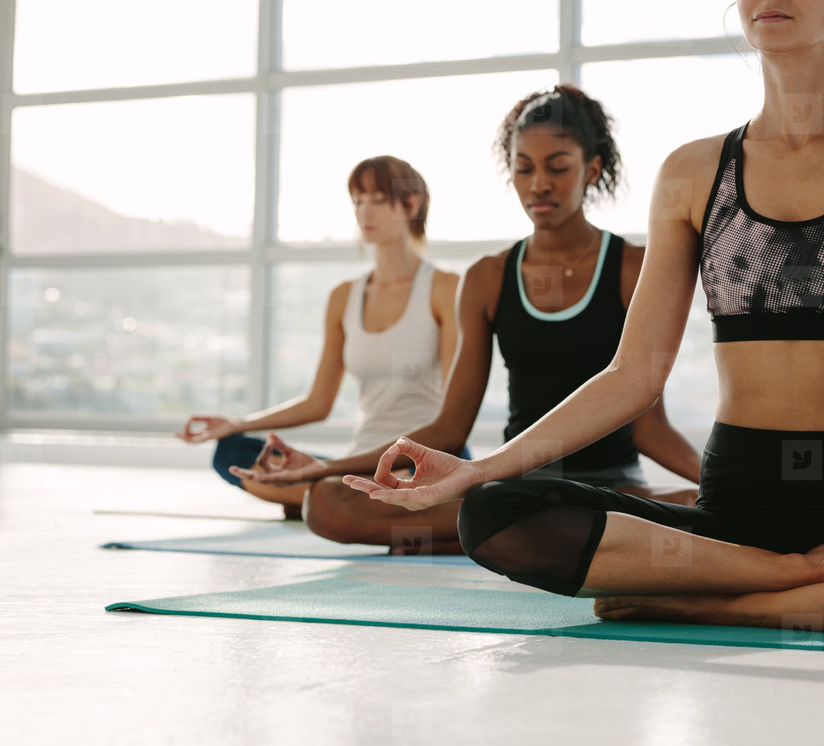 Women meditating in fitness studio