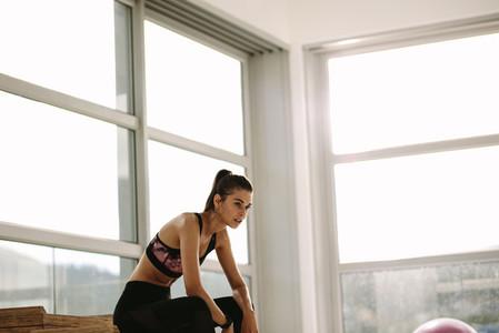 Woman taking break after exercising
