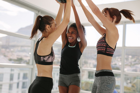 Smiling women having fun at fitness studio