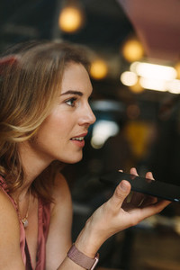 Woman talking over mobile phone