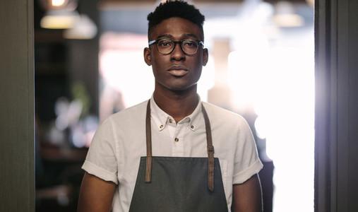 Young entrepreneur at his coffee shop
