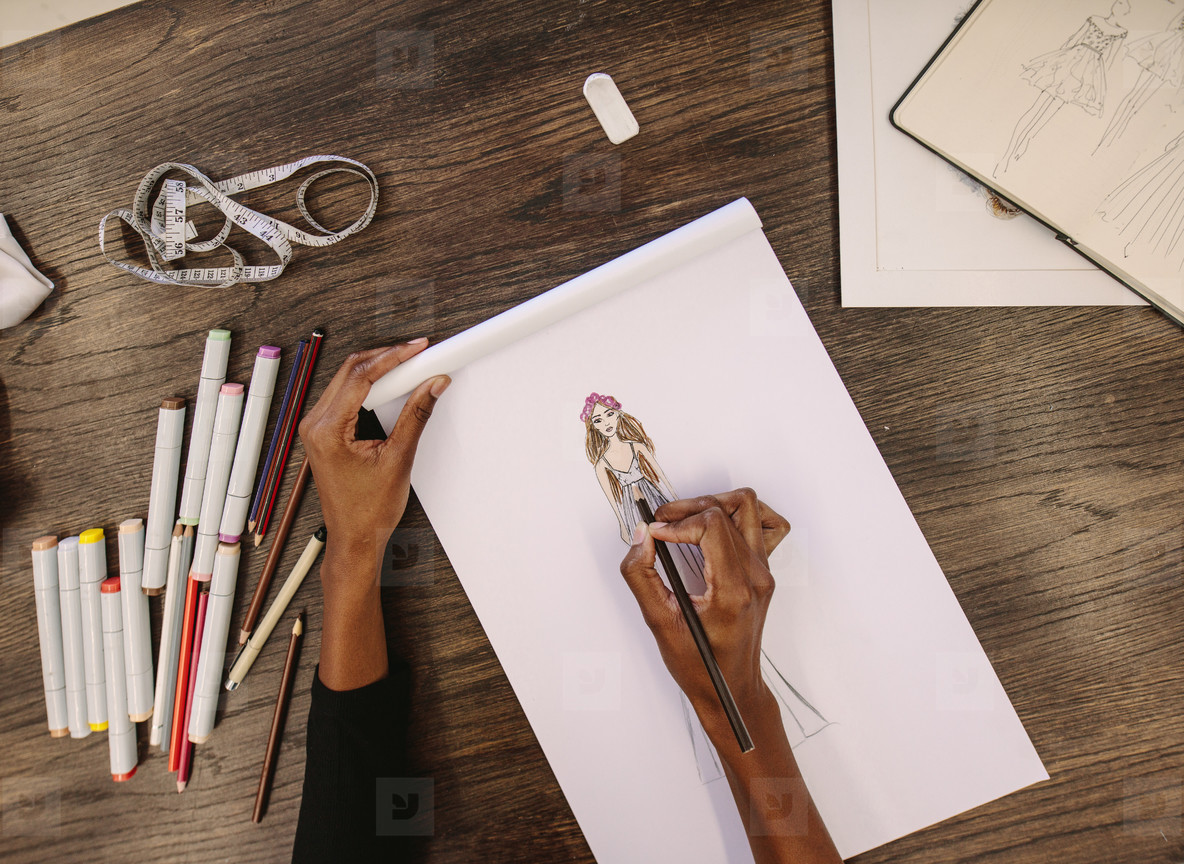 Fashion designer making a drawing in her studio