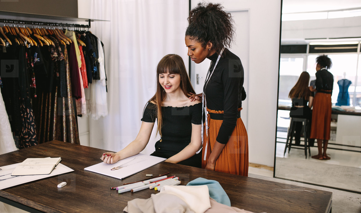 Woman entrepreneurs at work in their boutique