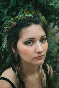 face of forest elf with plants in her hair  natural make up