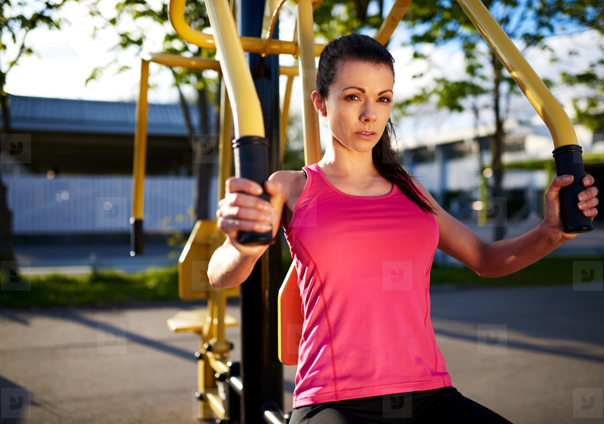 Woman exercising her upper body using weights machine