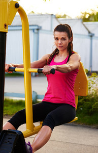 Woman smiling at camera while exercising lower body