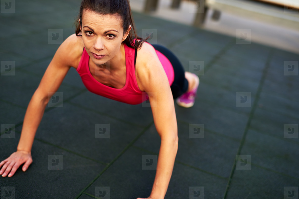 Woman looking up doing a push up