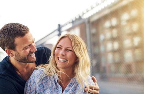 Happy vivacious couple enjoying a good joke