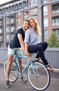 Loving couple riding bikes