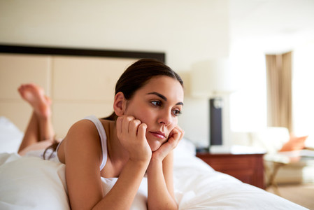Attractive woman lying in bed