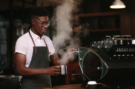 Barista preparing coffee at a coffee shop